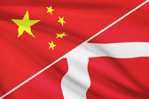 Series of ruffled flags. China and Kingdom of Denmark. — Stock Photo