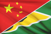Series of ruffled flags. China and Co-operative Republic of Guyana. — Stock Photo