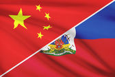 Series of ruffled flags. China and Republic of Haiti. — Stock Photo