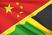 Series of ruffled flags. China and Commonwealth of Jamaica. — Stock Photo