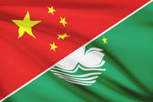 Series of ruffled flags. China and Macao Special Administrative Region of the People's Republic of China. — Stock Photo