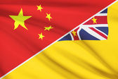 Series of ruffled flags. China and Niue. — Stock Photo