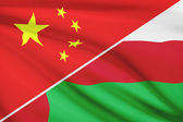 Series of ruffled flags. China and Sultanate of Oman. — Stock Photo