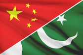 Series of ruffled flags. China and Islamic Republic of Pakistan. — Stock Photo
