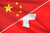 Series of ruffled flags. China and Swiss Confederation (Switzerland). — Stock Photo