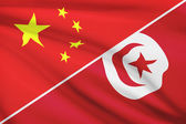 Series of ruffled flags. China and Tunisian Republic. — Stock Photo