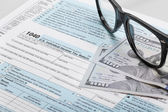 United States of America Tax Form 1040 with glasses — Stock Photo