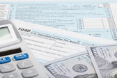 United States of America Tax Form 1040 with calculator and US dollars — Stock Photo