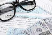 United States of America Tax Form 1040 with dollars and glasses — Stock Photo