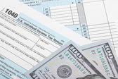 United States of America Tax Form 1040 with two 100 dollars banknotes — Stock Photo