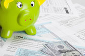 United States of America Tax Form 1040 with green piggy bank — Stock Photo