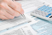United States of America Tax Form 1040 - man filling out tax form — Stock Photo