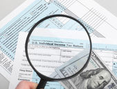 US Tax Form 1040 with magnifying glass — Stock Photo
