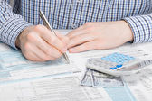 Male filling out 1040 US Tax Form — Stock Photo