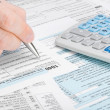 United States of America Tax Form 1040 - man filling out tax form - 1 to 1 ratio — Stock Photo #48797011