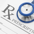 Stethoscope over blank medical prescription form - studio shot - 1 to 1 ratio — Stock Photo #48796967