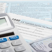 United States of America Tax Form 1040 with calculator and US do - 1 to 1 ratio — Stock Photo