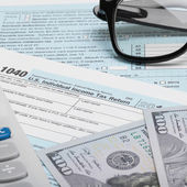 United States of America Tax Form 1040 with calculator, dollars - 1 to 1 ratio — Stock Photo