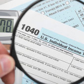 United States of America Tax Form 1040 with magnifying glass - 1 to 1 ratio — Stock Photo