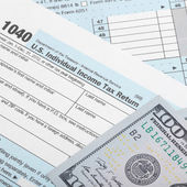 United States of America Tax Form 1040 with two 100 dollars bank - 1 to 1 ratio — Stock Photo