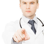 Young medical doctor pointing on viewer with his index finger - 1 to 1 ratio — Stock Photo