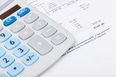 Utility bill with calculator — Stock Photo