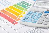 Energy efficiency chart with calculator - studio shot — Stock Photo