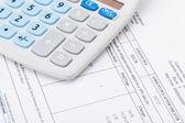 Studio shot of receipt next to calculator — Stock Photo