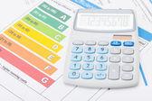 Calculator with energy efficiency chart - studio shot — Stock Photo