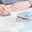 Male filling out 1040 USA Tax Form - studio shot — Stock Photo