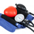 Blood pressure measuring tools with red toy heart - studio shoot on white — Stock Photo #50531741