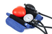 Blood pressure measuring tools with red toy heart - studio shoot on white — Stock Photo