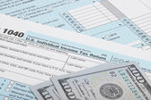 USA 1040 Tax Form with two 100 US dollar bills — Stock Photo