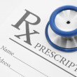 Stethoscope over blank medical prescription form - studio shot - 1 to 1 ratio — Stock Photo #50636371