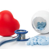 Stethoscope with red heart and pills - studio shoot on white - 1 to 1 ratio — Stock Photo