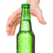 Hand trying to grasp bottle of beer - studio shot - 1 to 1 ratio — Stock Photo