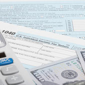 United States of America Tax Form 1040 with calculator and US dollars - 1 to 1 ratio — Stock Photo