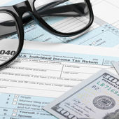 United States of America Tax Form 1040 with dollars and glasses - 1 to 1 ratio — Stock Photo