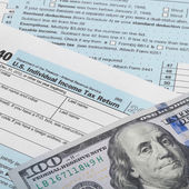 United States of America Tax Form 1040 with 100 dollars banknote - 1 to 1 ratio — Stock Photo