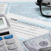 United States of America Tax Form 1040 with calculator, dollars and glasses - 1 to 1 ratio — Stock Photo