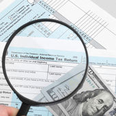 US Tax Form 1040 with magnifying glass - 1 to 1 ratio — Stock Photo
