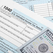 United States of America Tax Form 1040 with two 100 dollars banknotes - 1 to 1 ratio — Stock Photo