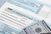 USA 1040 Tax Form with two 100 US dollar bills over it - studio shoot — Stock Photo