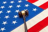 Wooden judge gavel over USA flag - studio shoot — Stock Photo