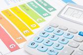 Energy efficiency chart with calculator over it - studio shot — Stock Photo