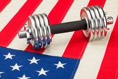 Dumbbells over US flag as symbol of healthy nation — Stock Photo
