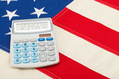Neat calculator over USA flag - studio shoot — Stock Photo