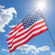 USA flag waving on blue sky background - 1 to 1 ratio — Stock Photo #50898949