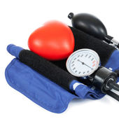 Blood pressure measuring tools with red toy heart - studio shoot - 1 to 1 ratio — Stock Photo