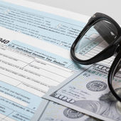 USA 1040 Tax Form with glasses and two 100 US dollar bills - 1 to 1 ratio — Stock Photo